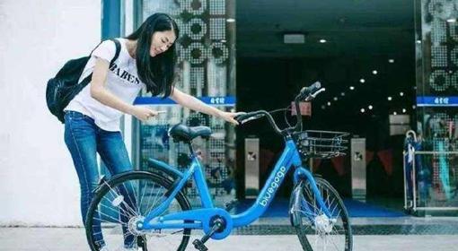 共用單車行銷戰再升級 摩拜花錢請用戶騎車.jpg