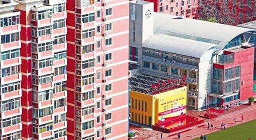 北京:開發商仲介不得炒作學區房高價房.jpg