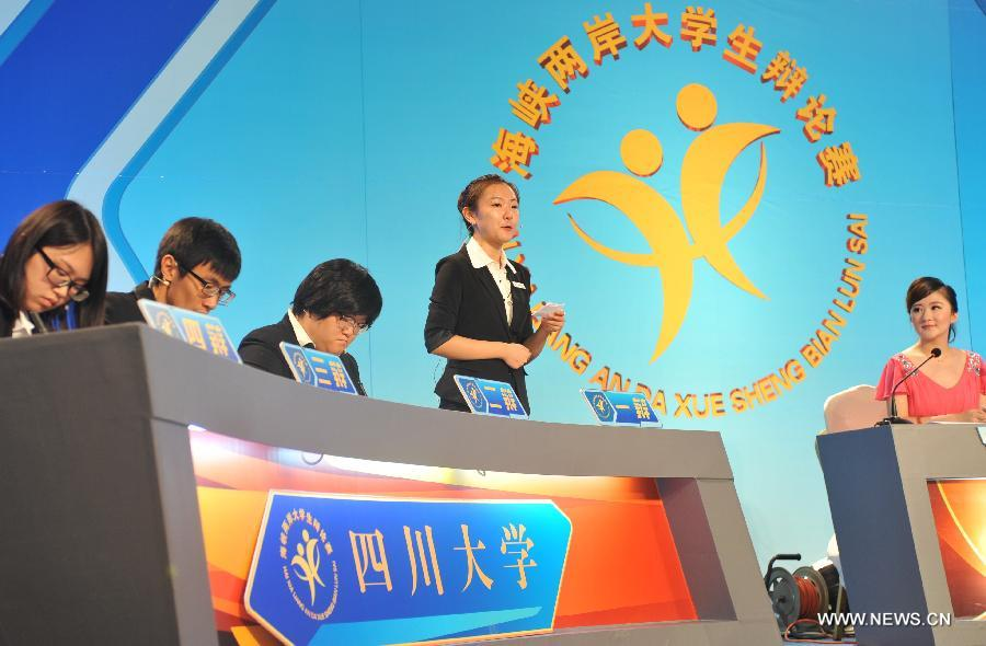 Students from Sichuan University compete in the 14th Cross-Strait University Debate Contest in Fuzhou, capital of southeast China's Fujian Province, July 20, 2015.